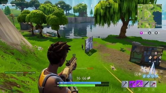 Um jogador constrói um muro para se proteger de tiros - Fortnite Battle Royale